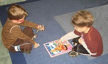 Boys putting puzzle together